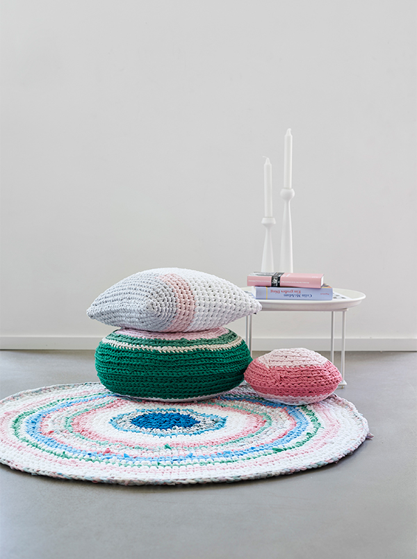 Cushions and rug made from crocheted recycled t-shirts by Lumikello