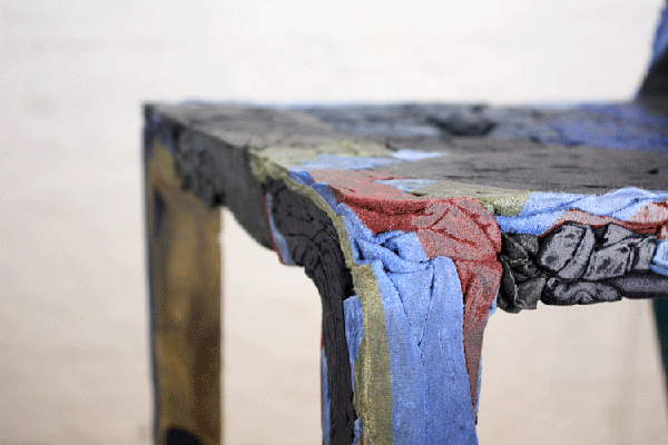 Detail of chair made from upcycled clothing and resin