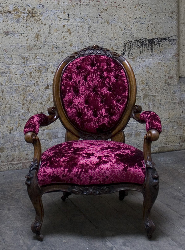 Pink crushed velvet upholstered armchair by The London Upholstery Collective