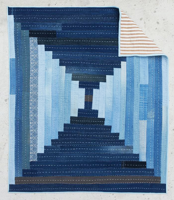 Quilt made from upcycled denim by Folk Fibers