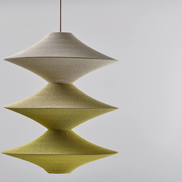 Yellow crocheted pendant light by Naomi Paul
