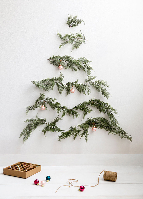 Christmas tree wall decoration made with pine branches