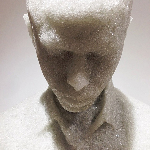 Detail of figurative sculpture made from shattered glass by Daniel Arsham