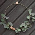 Foliage tied to brass wreath