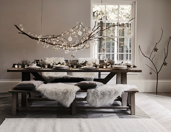 Natural branch centrepiece over dining table