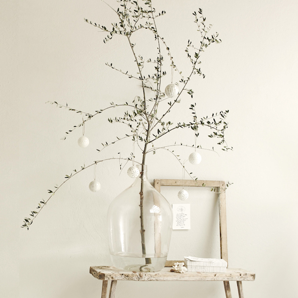 Simple natural branch decoration with white baubles