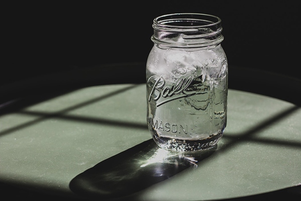 Glass jar of water and ice