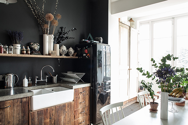Dark painted walls in modern East London kitchen
