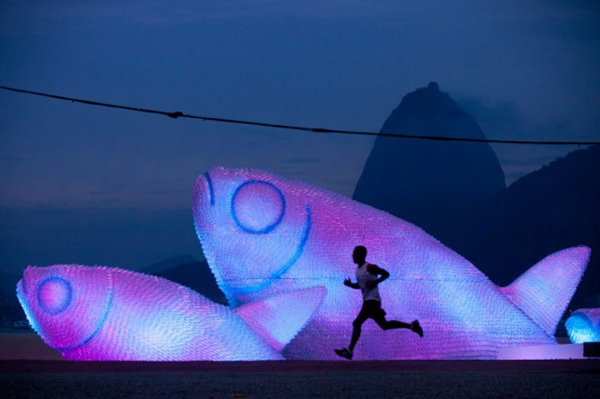 Illuminated fish made from plastic bottles in Rio