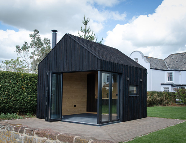Contemporary garden room made from charred larch wood