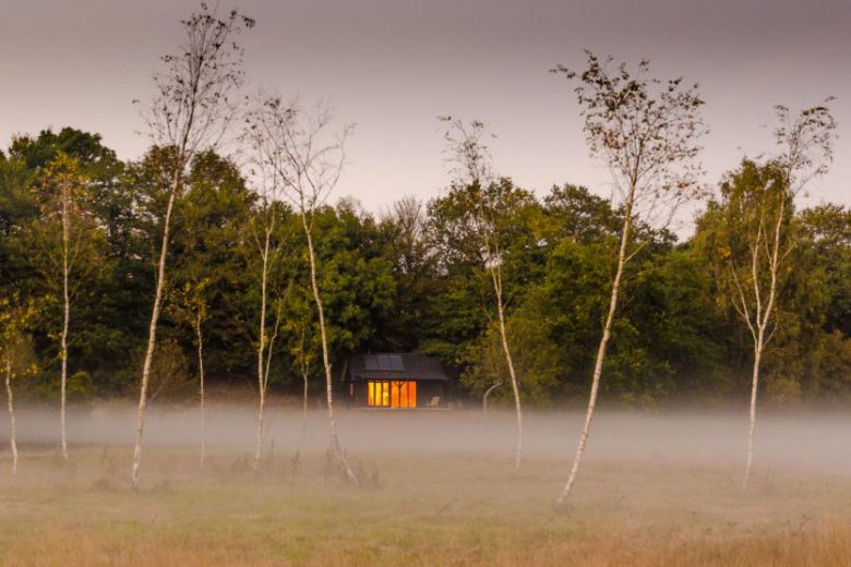 Wooden cabin in the mist