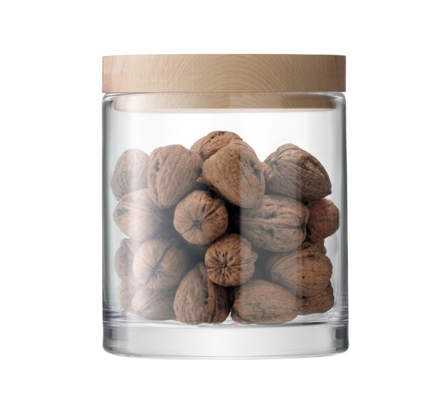 Glass jar filled with walnuts