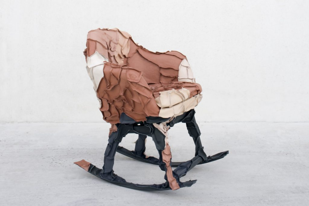 Skin collection chair covered in leather scraps
