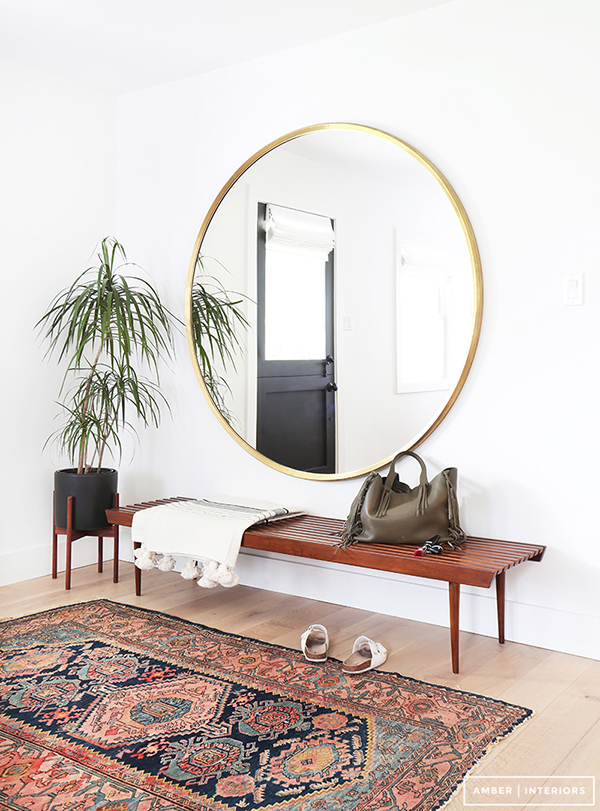 Large round mirror in modern hallway