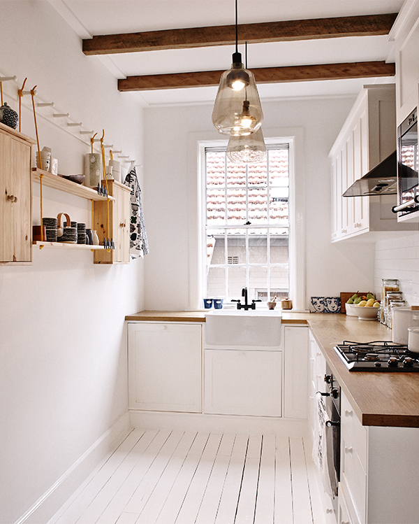Light and bright small kitchen with painted white floors
