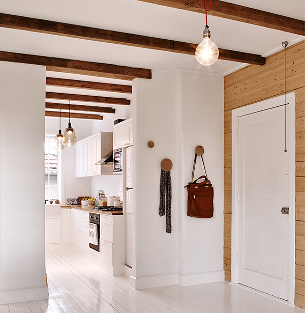 White painted modern kitchen with beams
