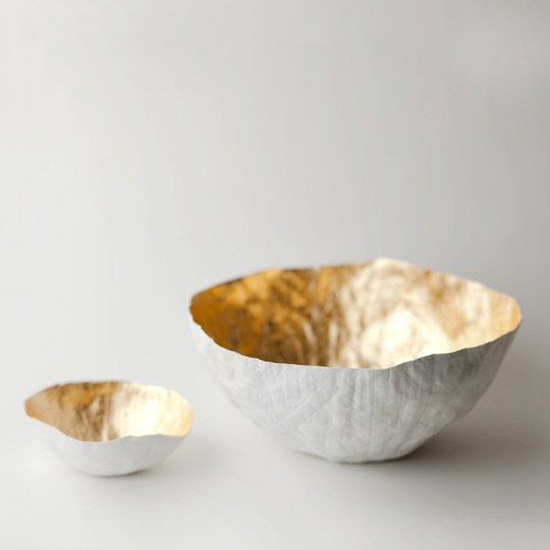 White paper mache bowls with gold interior