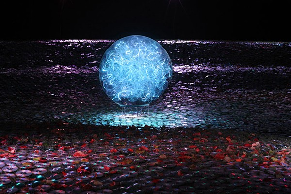 Detail of Blue moon on a platter CD art installation by Bruce Munro