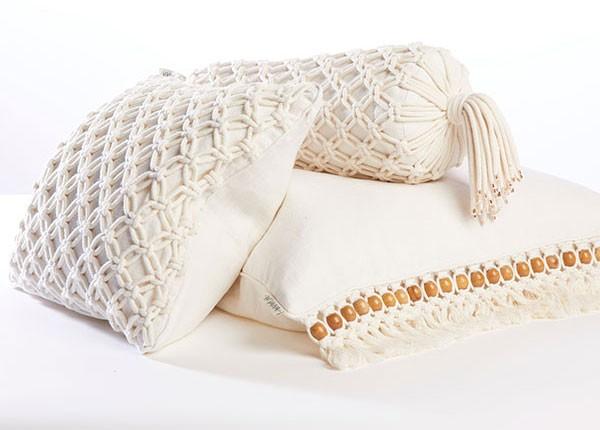 White macrame cushions