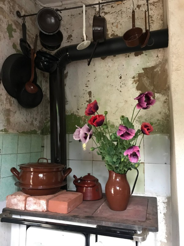 Traditional stove in a dilapidated cottage