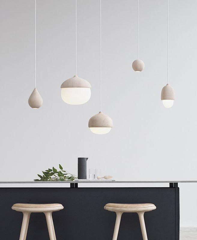 Wood pendant lighting over kitchen counters by Mater