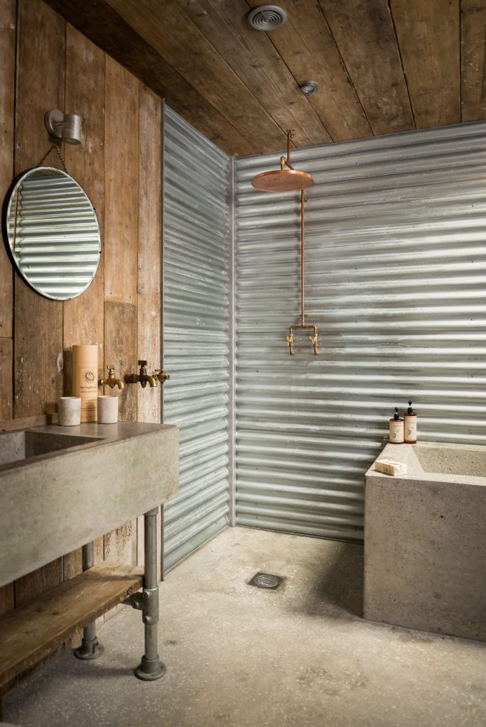 Bathroom area in a cabin built from recycled materials